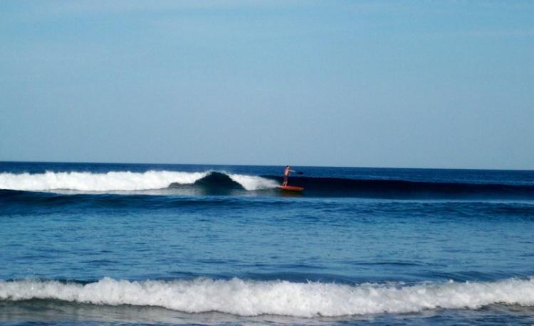 Jamie sup surfing